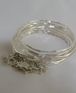 Adele Marie - slim structured silver bangles with star-charms