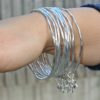 Adele Marie – SLIM STRUCTURED SILVER BANGLES WITH STAR-CHARMS