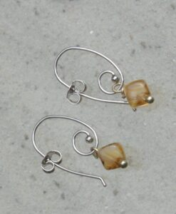 Evelynsdottir - Silver plated drop earrings with square beads in amber style